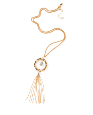 Women's gold pendant necklace with a suspended diamond and gold tassel.