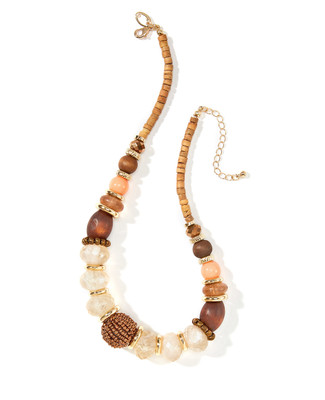 Women's beaded statement necklace with wooden beads mixed with gold and peach accents.