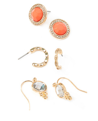 Women's gold and coral stud earrings set.