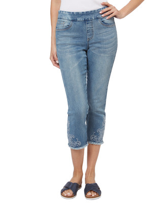 Women's embroidered capri jean with raw edge finish.