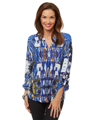 Women's long sleeve patterned blouse with a beaded top.