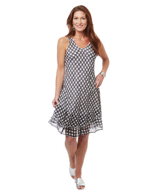 Women's black and white checkered dress with layered hem.