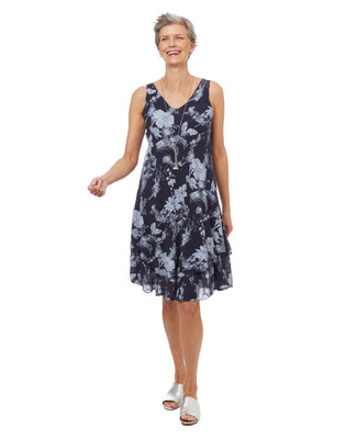 Women's flowy a line dress in a navy floral print.