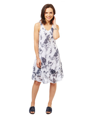 Women's black and white floral dress with layered hem.