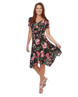 Women's handkerchief hem dress in black with an all over pink floral print.