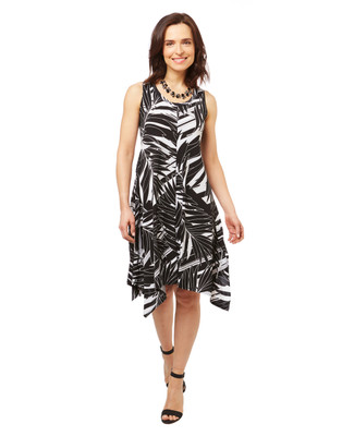 Women's handkerchief hem dress in a black and white floral print.