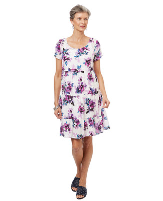 Women's tiered swiss dot babydoll dress in a lilac floral print.
