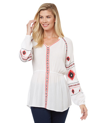 Women's aztec print blouse is embroidered on a flowy crinkle fabric.
