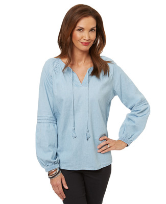 Women's peasant top blouse in a light denim-style fabric.
