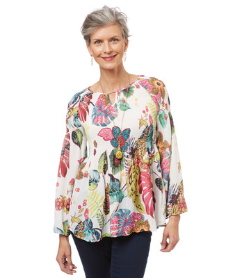 Women's white bell sleeve top in a tropical print with ruffled hem