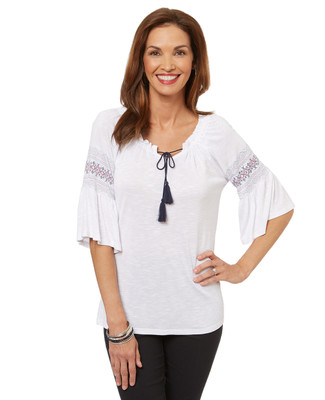 Women's white peasant top with bell sleeves.
