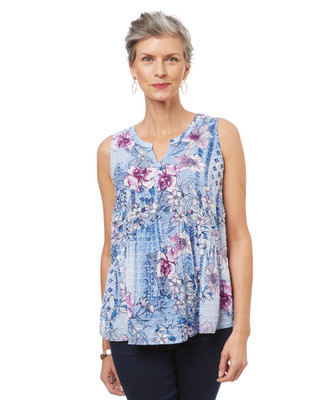 Women's sleeveless peplum top in a blue and purple floral print