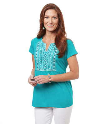 Women's peplum blouse in seagreen with an embroidered bib.
