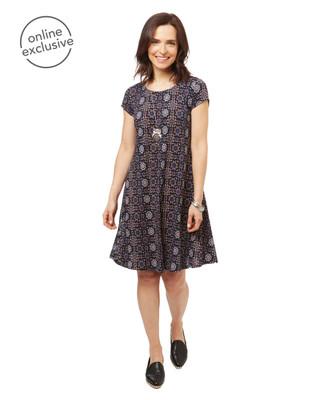 Women's short sleeve boho swing dress in a black geometric print.