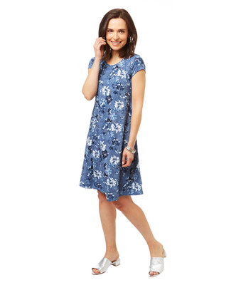 Women's flowy light denim swing dress with all over floral print.