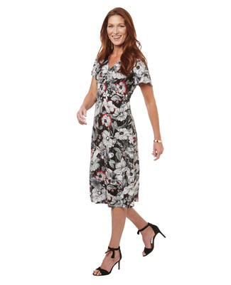 Women's midi length black and white floral print summer dress with red accents.
