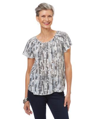Women's petite white blouse in a tie dye print.