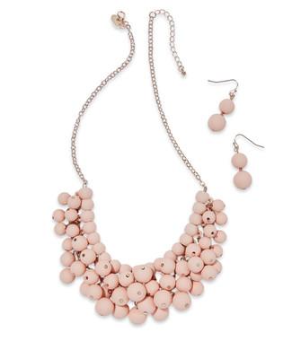 Women's faded pink beaded bib necklace set
