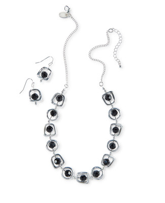 Women's silver necklace with black stones and cut-out disc details