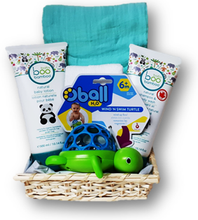 All natural body wash and soothing lotion, wind up bath toy, wash cloth and muslin swaddling cloth make bath time fun for baby boy.