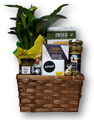 Send your sincere condolences during a difficult time.  Beautiful potted plant is surrounded by an assortment of imported cheese, crackers, condiments and truffles