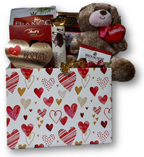 Send a sweet embrace with this hug-able plush and assortment of chocolates and cookies.
