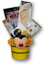 This cute ceramic bee planter has a selection of delicious treats - cookies, candy and chocolate.  Perfect for the busy Mom!