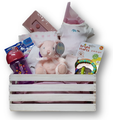 This wooden crate is filled with baby items and makes a great diaper caddy or storage bin.  Little treasures include a onsie, swaddling blanket, socks, plush, and wooden clothing hanger.