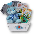 Celebrate the new arrival of a baby boy with this assortment of items:  onsie, rattle, soother, teether, diaper cream and plush bear.