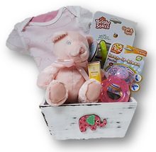 Celebrate the new arrival of a baby girl with this assortment of items:  onsie, rattle, soother, teether, diaper cream and plush bear.
