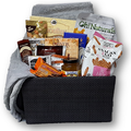 This basket is filled with tea, jam, cookies, biscotti, chocolate, candy and cozy fleece throw - perfect for whiling away a quiet afternoon.