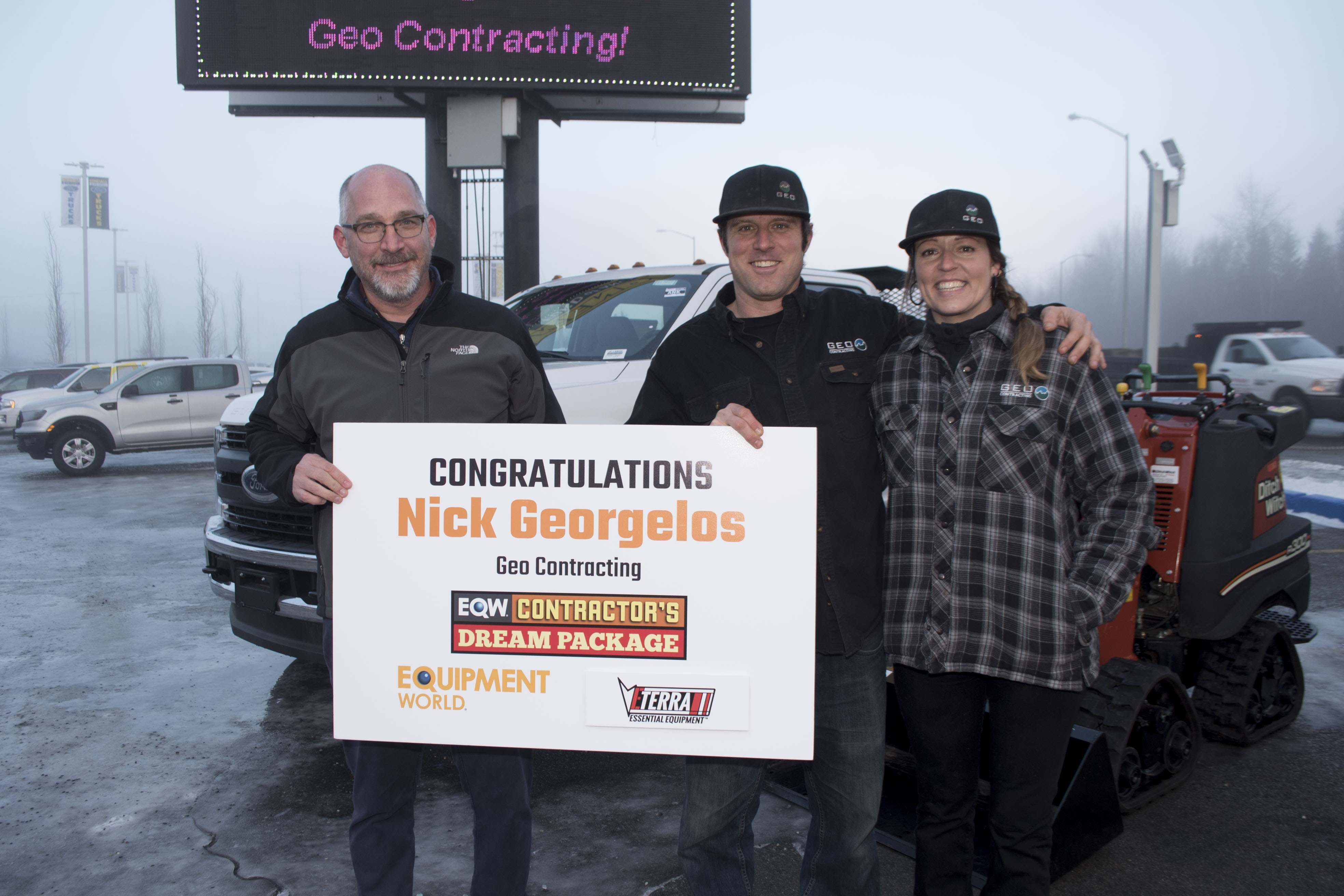 Contractor's Dream Package Winner Nick Georgelos, middle, and his wife Lauren