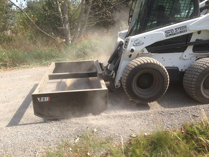 One Gravel Road, One Machine and One Box Grader Attachment