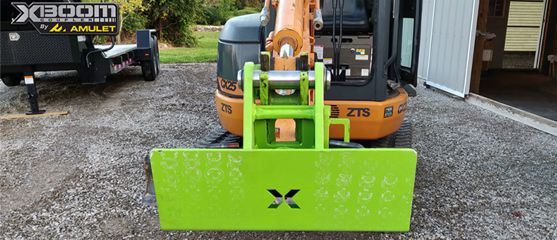 XBoom Excavator To Skid Steer Attachment System