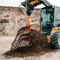 John Deere Skid Steer Loader with a Pengo CS-4 Auger Attachment