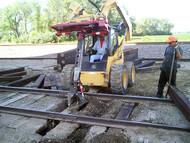 Railroad Tie Grapple Attachment from EZSPOTUR