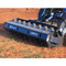 Bradco Padded Vibratory Roller Attachment for Skid Steer Loader Action