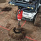 Eterra skid steer auger drive drilling holes in soft earth conditions.