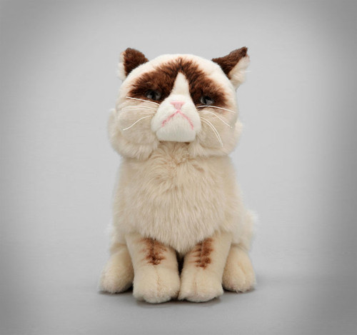 """Now you can show off your love for the internet's favorite kitty curmudgeon by bringing home your very own Grumpy Cat! Our 9"""" plush version features an accurate grouchy expression, as well as realistic details. Plush 9 in H Realistic plush replica of Grumpy Cat with accurate grouchy expression and details Made from soft, huggable material that meets famous GUND quality standards Surface-washable construction for easy cleaning Suitable for ages 1+ 9 inch height (23 cm)"""