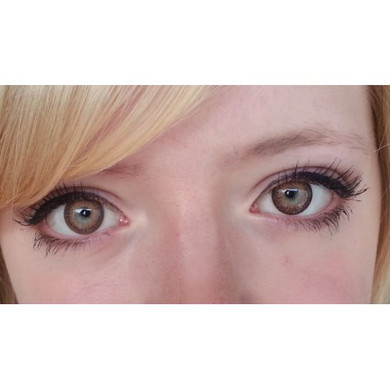 Geo Twins YH306 circle lenses in Brown over light eyes for a complete color change.