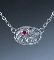 fine silver reticulated pendant with a ruby set in 14k gold on sterling silver chain