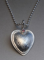 sterling silver heart with a rhodolite garnet on a sterling ball chain
