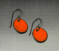 Orange enamel on copper with sterling earlier.  10mm diameter