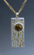 A box pendant made of fine silver, sterling silver, 24k gold, 22k gold and citrine