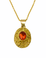 Stunning  18k textured pendant with a Mexican fire opal on an 18K chain.  Chain priced separately.