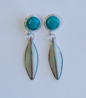 Turquoise set in Sterling Silver with winter green enamel leaf dangle