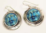 Iridescent pressed glass earrings with a blue moon motif. Set in sterling silver with sterling silver ear wires