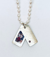sterling silver locket pendant with faceted garnet