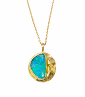 Boulder opal set in 14K yellow gold