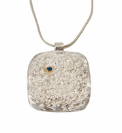 Sterling silver lava rock texture pendant with blue sapphire set in 14K gold